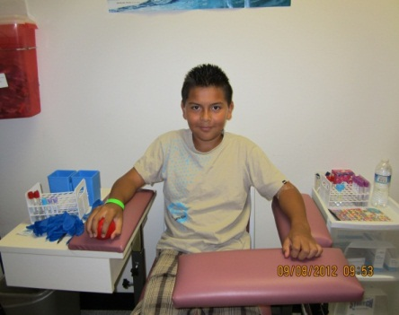 SOL Youth participant preparing to donate blood sample